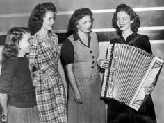 """September 1944 - the Carter Sisters. They were radio regulars in Richmond in mid-1940s. From left are Anita, June, mother Maybelle  Helen. They were often featured  in """"The Old Dominion Barn Dance"""" at the Lyric Theater downtown on Saturday nights. After leaving Richmond, they became regulars at the Grand Ole Opry."""