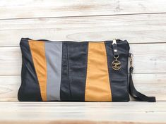 Leather Clutch with Black Grey and Mustard . . The leather on the front panel of this beaut is up-cycled from 2 leather jackets and a leather skirt.  . . Inside is lined with wrap scrap and has a zipped pocket. The wrist strap is detachable.  . . And its on my shop now!  . . #daggerandthorn #sewteadough #leather #bag #clutch #leatherclutch #reclaimedleather #upcycle #reuse #reducereuserecycle #sustainablefashion #shopsmall #shopirish #shoplocal #championgreen #gogreen… Reduce Reuse Recycle, Upcycle, Leather Clutch, Leather Skirt, Leather Jackets, Sustainable Fashion, Mustard, Messenger Bag, Diaper Bag