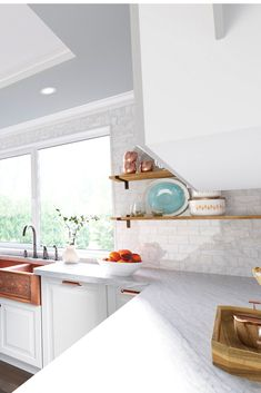 This transitional kitchen showcases classic design elements and sleek, rose-gold and copper finishes.