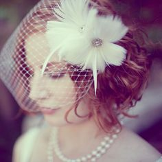 Curly wedding hairstyles for short hair. I really like the idea of wearing a birdcage veil as well!