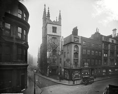 The tower of the church of St Andrew Undershaft, seen from the junction of Leadenhall and St Mary Axe. Please click the image for more information or to search our catalogue. Uk History, History Photos, British History, London Pictures, Old Pictures, Old Photos, Vintage Photos, Vintage London, Old London