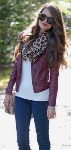 Jeans and a tee plus muted color leather jacket and leopard scarf