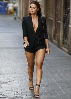 Summer style: Featuring an extremely plunging neckline, the garment allowed the ITVBe star...