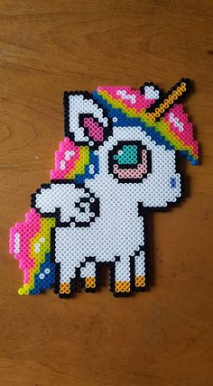 Stoned Unicorn/Pegasus perler by LadyRaveicorn Perler Bead Ornaments Pattern, Ornament Pattern, Diy Perler Beads, Perler Bead Art, Beaded Ornaments, Melty Bead Patterns, Pearler Bead Patterns, Perler Patterns, Beading Patterns