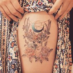 Thigh tattoo with stag, peonies, and a crescent moon by Grain