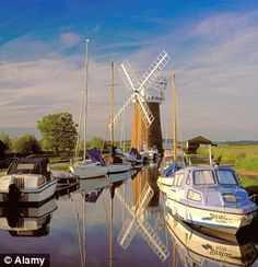 New Lonely Planet guidebook slams Britain as 'overpriced' for tourists Norfolk Broads, Visit Uk, Places In England, Uk Holidays, Places Of Interest, Le Moulin, Windmills, British Isles, Lonely Planet