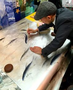 de Gournay artist at work - painting our Fishes wallpaper