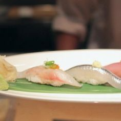 How to eat sushi.  http://mobile.designtaxi.com/news/352602/Sushi-Chef-Shows-You-The-Proper-Way-Of-Eating-Sushi/