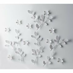 I bet I could make this.  Canvas, dollar store plastic flowers, white spray paint?