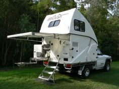 Australian-made Innovan truck camper. The top folds down, forming a flat surface nearly flush with the truck cab in the travel mode.