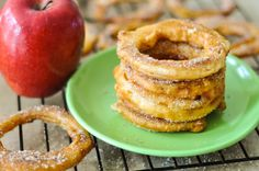 Apple Cinnamon Rings - apple rings dipped in a delectable batter, fried to golden perfection and tossed in a cinnamon sugar mixture...get the recipe at http://crumbsandtales.com/apple-cinnamon-rings/