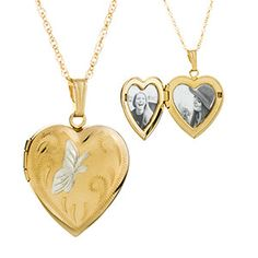 Elegant silver butterfly rests beautifully on these gold engraved lockets
