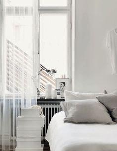 simple charming bedroom in soft tones  + metal hues