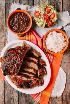 Pernil-Style Roast Pork | Complete with beans, rice, and a simple salad on the side, this one of my favorite roast recipes, because it is just out-of-this-world tasty and permeates the entire house with a beautiful porky, Latin food aroma @thewoksoflife1