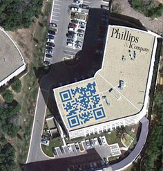 On the roof of a building: intended for Google Earth (or passing balloonists perhaps) but it seems to be a lot of effort for the slight chance that someone will scan it.