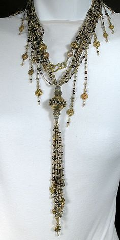 """Lucia Antonelli Necklace. Part of her """"Luscious"""" 2007 show. """"Majesty"""" Long Strands of 23 k gold, Plated Antique French Brass mixed with garnet, Antique 22 and 24k Gold Beads (India), Antique Silver, 18k Gold Wire and Beads, Fresh Water Pearls. Center Beads is either 22 or 24k Gold."""