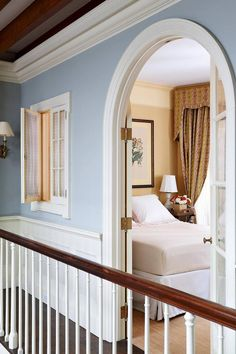 [i]A hallway with light blue walls and a charming window looking into a bedroom. Light Blue Houses, Light Blue Rooms, Light Walls, Blue Hallway, Hallway Paint, Room Paint, Blue Bedroom Walls, Master Bedroom, Home Decor Bedroom