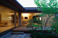 This timber-framed house in Japan's Ehime Prefecture was designed by architect Takashi Okuno with a sprawling plan that frames five separate gardens and terraces.