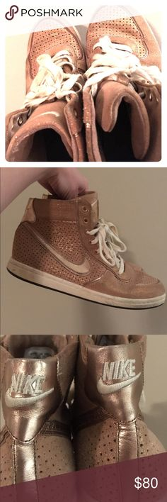 Women's Nike Hi-Top Sneakers Lightly worn rose gold metallic Nike Hi-Top sneakers. I love these shoes but they are too big, so they have rarely been worn! Nike Shoes Sneakers