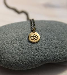 One of my favorite sayings is: No mud, no lotus. My hope is that this necklace reminds you that the tough stuff in your life becomes compost for all the goodness that blooms within.