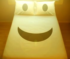 Happy Smiley Face duvet cover and pillow cases.  This would totally crack me up coming to bed and seeing this.
