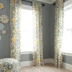 curtains. I used this fabric (Waverly pom pom play print from Joann's) to make curtain panels for the bay window in our study, which is a gray color on the walls. Love them. I did a grommet top tho.