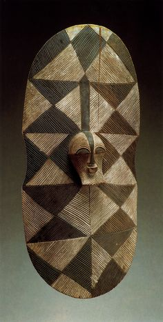 Songye, D.R.Congo Shield with kifwebe (mask). Wood, black and white pigment Height: 76,5 cm. Acquired by Josef Müller before 1939.	 Genf, Schweiz, Musée Barbier-Mueller. in: Werner Schmalenbach (Editor) – African Art from the Barbier-Mueller Collection, Geneva; Prestel Verlag, Munich 1988. S. 264, Photograph: Roger Asselberghs