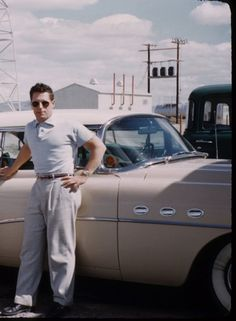 Sharp dressed man with pink 1954 Buick Super