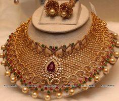 1. Round uncut chakri diamonds, pear shaped rubies, emeralds studded borad bridal uncut diamond necklace with pearls drops and jhum...