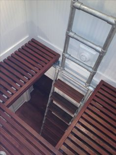 ships ladder to a private loft made of ipe wood and keeklamp pipe fittings and galvanized