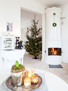 Fireplace and Christmas tree in Sweden. Scandinavian winter holiday