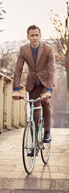 Hey, I would go on a bike ride with Tom, if he were a true cyclist. But, being that he's a runner....he would have to run along side of me while on my bike! Hahahaha!! Besides......he's not dressed for it. :D :D