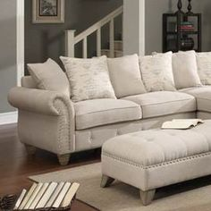 """Pairing button-tufted upholstery and a nailhead trim, this inviting left-facing loveseat infuses your living room or den with contemporary style.   Product: LoveseatConstruction Material: Solid wood and linenColor: BeigeFeatures: Pillow back design Nailhead trimButton-tufted Dimensions: 36.2"""" H x 69"""" W x 35"""" D Note: Product is a left-facing loveseat. To be paired with the Georgina Chaise Lounge to make a complete sectional sofa."""