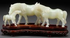 A CHINESE CARVED WHITE JADE FIGURAL HORSE GROUP, : Lot 588