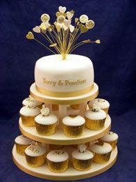 Love this set up with the small cake on top with cupcakes below
