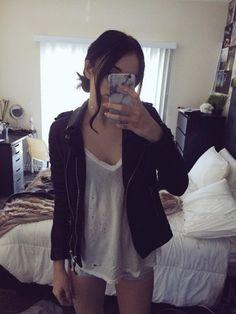 Acacia Brinley wearing a black leather moto jacket