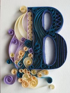 Paper quilling letters is one of the best way to use quilling ideas to make beautiful letters and patterns.Sabeena Karnik paper quilling is popular. Arte Quilling, Quilling Letters, Paper Quilling, Paper Letters, Quiling Paper, Quilling Images, Craft Letters, Monogram Letters, Fun Crafts