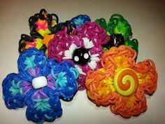 Rainbow Loom PRIMROSE FLOWER Charm. Designed and loomed by Ellen Carpenter at feelinspiffy. Click photo for YouTube tutorial.