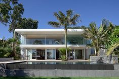 Wthie contemporary exterior and pool with water feature | Usual House