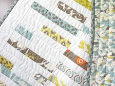 Quilts for the girls...Love this mostly white--use girls' old baby clothes for the patterned pieces.