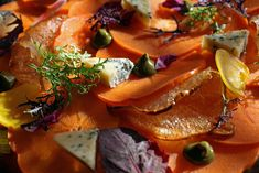 Persimmon, Beets and Pears with stilton, pistachio butter, and cider gastrique is displayed as part of a luxurious yet rustic dinner party t...