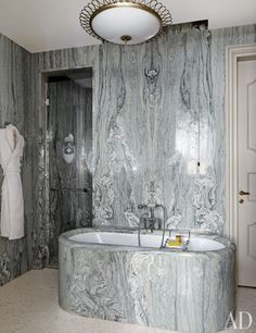 The bath of the Peggy Guggenheim Suite at Venice's Gritti Palace hotel is sheathed in Cremo Tirreno marble.