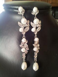 Lolita Swarovski crystal and pearl bridal  by simplychic93 on Etsy, $46.00. definitely my favorite!!!!
