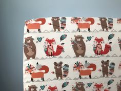 A personal favorite from my Etsy shop https://www.etsy.com/listing/531459869/woodland-animal-bedding-tribal-baby