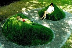Moss/Grass covered garden chairs. By environmental artist Angela Ciotti from a 1983 installation in Pennsylvania.