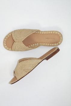 The ultimate slide for pretending you're in Tulum, or, you know, for  actually going there. Up to you. The naturalistic style is inspired by  traditional Moroccan slip-ons and is a must for laid back summer  outfits. Padded leather sole adds comfort and ensures sturdy wear. By  Carrie ForbesRaffia upper, Italian leather sole.Handwoven in Morocco.Size  37 insole length measures 23.5 cm.Size 38 insole length measures 24.1  cm Size 39 insole length measures 25.1 cm Size 40 insole length…