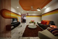 Retro home with psychedelic details, orange tones and bold stripes.