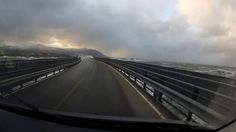 The Atlantic Ocean Road or the Atlantic Road (Norwegian: Atlanterhavsveien) is a 8.3-kilometer (5.2 mi) long section of County Road 64 that runs through an archipelago in Eide and Averøy in Møre og Romsdal, Norway. It passes by Hustadvika, an unsheltered part of the Norwegian Sea, connecting the island of Averøy with the mainland and Romsdalshalvøya peninsula. It runs between the villages of Kårvåg on Averøy and Vevang in Eida. It is built on several small islands and skerries, which are…