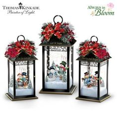 Limited-edition metal lanterns feature fully-sculpted snowmen with Thomas Kinkade art, starry string lights, Always in Bloom® evergreen toppers.
