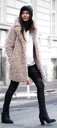 Laura Dittrich is wearing a pink fluffy coat from Supertrash